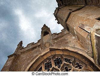 Medieval church in darkness - Dark clouds above an English...