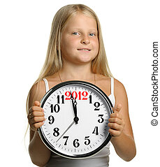 The girl hold in hands a big clock with figures 2012. It is...