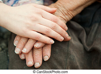 Old and young hands. Hands of the old woman - 84 years...