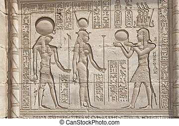 Hieroglypic carvings on an egyptian temple - Hieroglyphic...