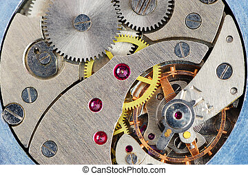 The mechanism of old hours. A photo close up.