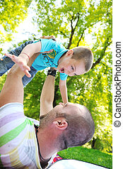 happy father and son have fun at park - family father and...