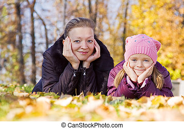 woman with her daughter in autumn