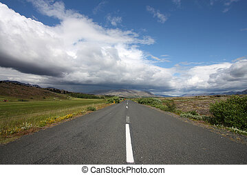 Iceland - Thingvellir - Cloudy weather. Road in Thingvellir...