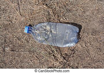 plastic bottle on the ground