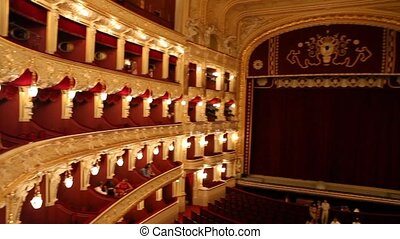 Odessa theatre - Classical theater interior with red seat...