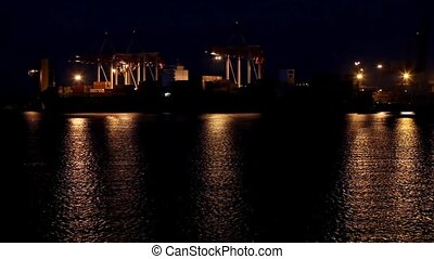 Port at night. Odessa, Ukraine - Port warehouse with cargoes...