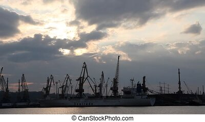 shot during sunset Odessa, Ukraine - Silhouette of several...