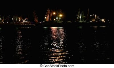 Port at night Odessa, Ukraine - Port warehouse with cargoes...