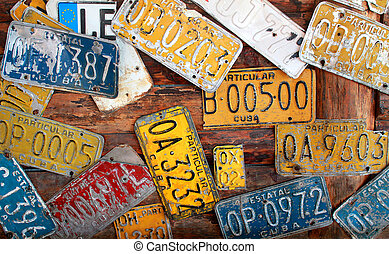 Old Cuban license plates on wall - Collection of old Cuban...