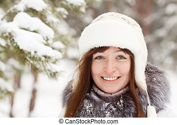 smiling girl in wintry park - smiling girl wearing white cap...
