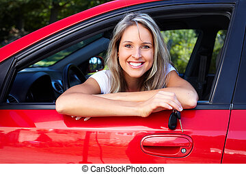 Family car - Happy smiling woman with car key Driving