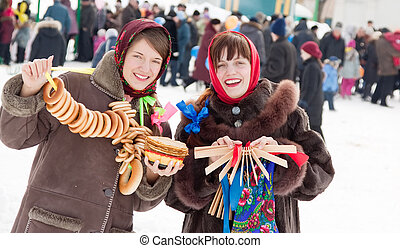 happy girls plays Shrovetide at Russia - Two happy girls...