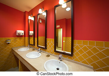 Interior of toilet with few sinks in restaurant