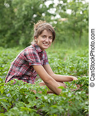 Girl working  in field