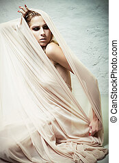 Cocoon - A woman trying to get out of the cocoon of beige...
