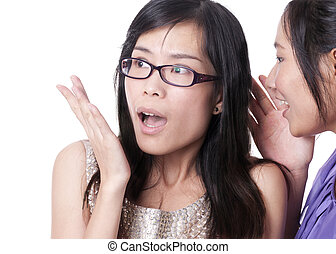 Suprised to hear secret - Girl telling a secret to another -...