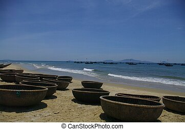 Round bamboo boats - On the beach round bamboo boats of...