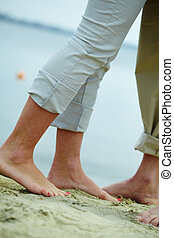 Feet of dates - Image of male and female legs standing on...