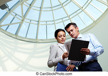 Teamwork - Image of confident businessman looking at...