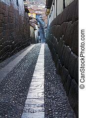 Cusco - Old narrow street in the center of Cusco Peru