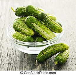 Small cucumbers in bowl - Fresh green pickling cucumbers in...