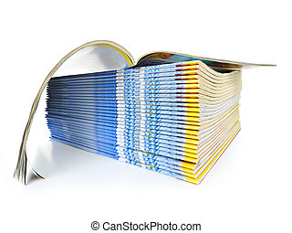 Stack of magazines - Many magazines stacked in a pile with...