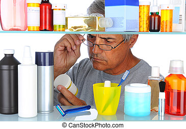 Middle aged man in front of medicine cabinet - Unshaven...