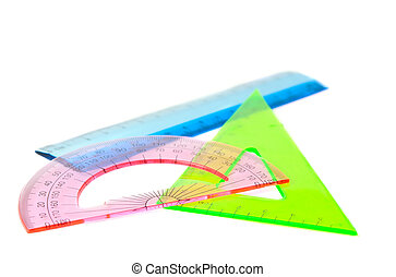 ruler, protractor, triangle on a white background