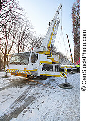 Mobile crane truck lifting structure at construction site