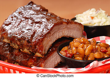 BBQ Ribs with beans and cole slaw - Delicious BBQ ribs with...