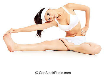 slender - Shot of a sporty young woman doing yoga exercise....