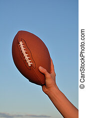 American Football Player Holding the Ball