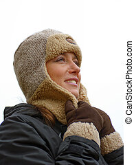 woman in warm winter clothes on white background