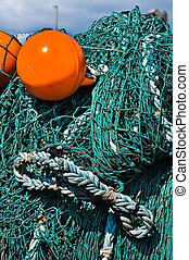 Close-up fishing net with a bright orange floats.