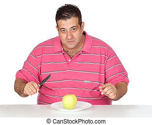 Fat man eating a apple