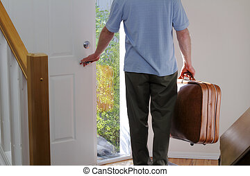 Leaving Home - A man carrying a suitcase about to walk out...