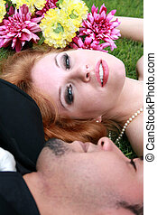 Bride and Groom lying on grass - Bride and Groom lying in...