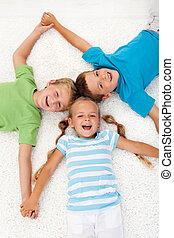 Happy laughing kids on the floor - Happy healthy laughing...