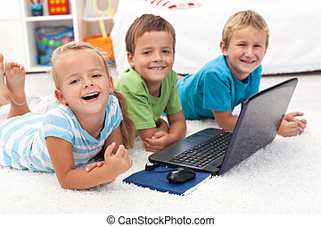 Happy healthy kids with laptop computer