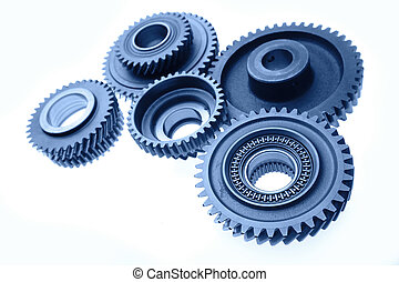 Gears - Steel gears meshing together on plain background