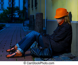 Beautiful girl in european old city at night time