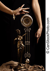 Yong girl's hands and antique clock