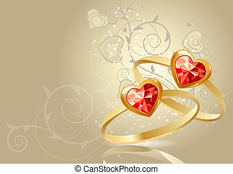 Two gold rings with gems on beige background