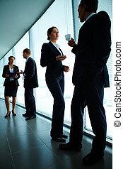 Interacting in office - Image of smart employee looking at...