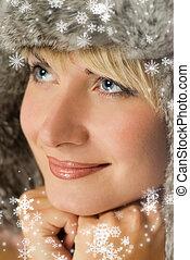 Beautiful girl in winter fur-cap