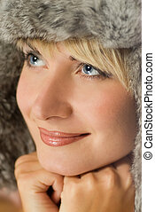 Beautiful girl in winter fur-cap