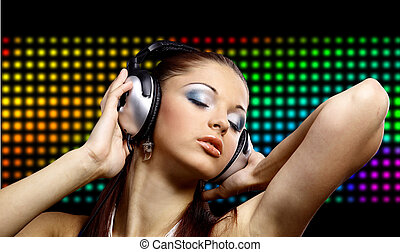 Portrait of a young dancing girl in headphones