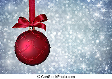 Christmas ornament hanging with ribbon on silver background