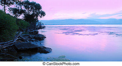 Sunrise on riverbank - beautiful panoramic sunrise over...